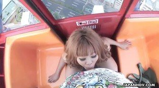 Asian babe sucking a dick on a ferris wheel