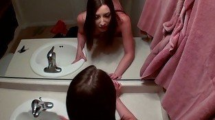 Busty brunette fucked in front of a mirror