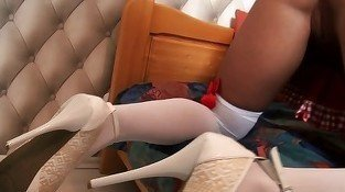 Leggy chick in white stockings teasing her welcoming hole