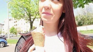 Redhead eats an ice cream in a very hot way
